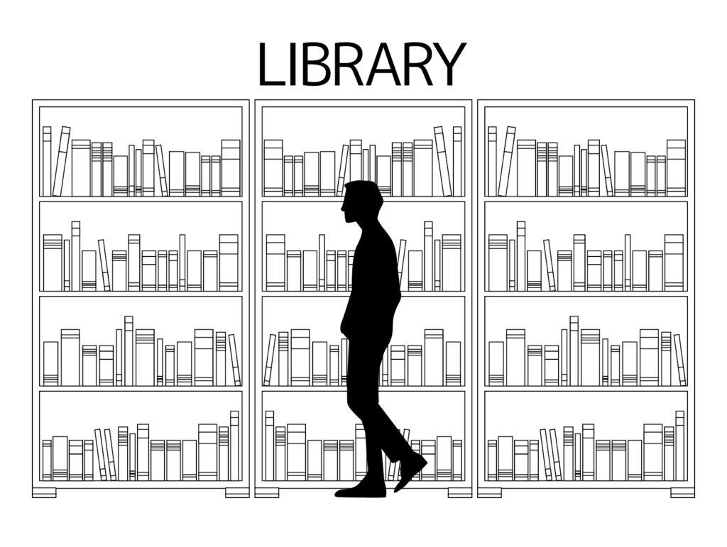 図書館で本を選ぶ人